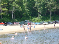 Families swimming at Townshend Lake, Townshend, Vt., is nestled in the foothills of the Green Mountains and offers lots of outdoor recreation fun. Families come to enjoy the extensive shaded picnic areas overlooking the swimming and play areas. Picnic tables, grills, horseshoe pits, volleyball set-ups, grassy play areas, and two modern restrooms are provided for the enjoyment of our visitors.
