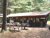 The Davis shelter at Townshend Lake, Townshend, Vt. At Townshend Lake, picnickers can dine in shady woods or take advantage of our covered picnic shelters. Our shelters can be reserved, for a fee, for large gatherings such as family reunions or weddings. Grills are provided at the shelters, with playground equipment, horseshoe pits, and restrooms nearby.
