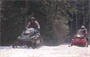 Snowmobilers riding trails in Blackwater reservoir. The Blackwater Dam offers visitors approximately 3,600 acres of land and water for recreational opportunities all year round. The pristine environment includes a meandering eight mile stretch of the Blackwater River.