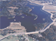 Aerial view of Mansfield Hollow Lake Dam, which lies on the confluence of the Natchaug, Fenton, and Mount Hope Rivers, in the township of Mansfield Center, Conn. The dam is part of a network of six flood control dams in the Thames River Basin, that were constructed and are maintained by the U.S. Army Corps of Engineers. This network helps to reduce flooding in communities along the Thames River by controlling water on upstream tributaries in Massachusetts and Connecticut.